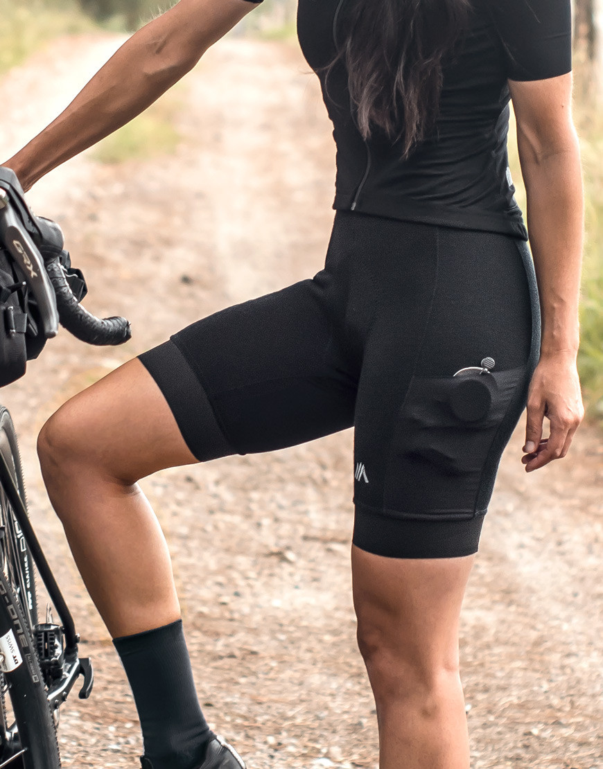 Women's merino wool bibs with plant-based reinforcements and cargo pockets