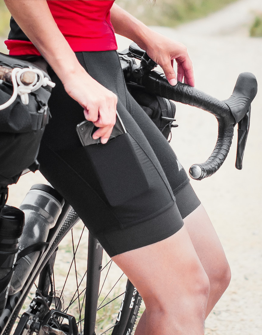 Women's merino wool cycling bibs with plant-based reinforcements and cargo pockets